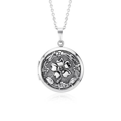 Relicario floral redondo de estilo antiguo en plata de ley