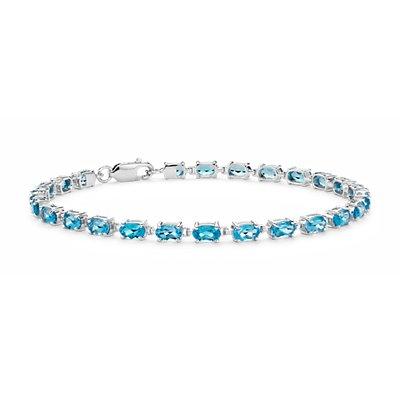 Petit bracelet ovale à topaze bleu intense en argent sterling (5x3mm)