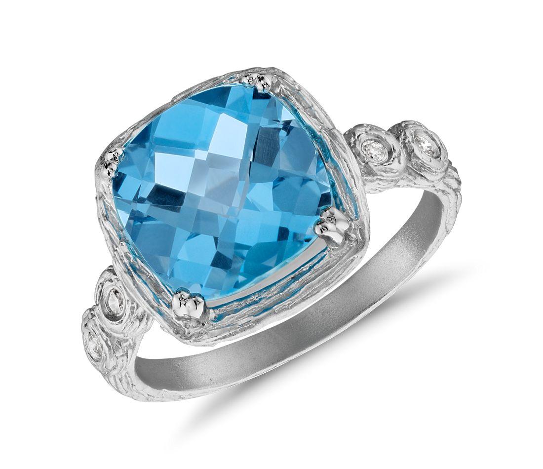 Bague diamant et topaze bleue suisse coussin en or blanc 14carats brossé