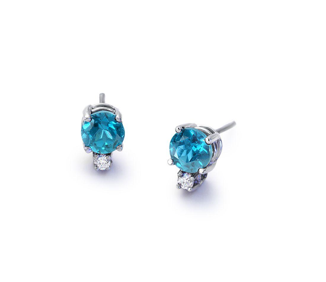 Puces d'oreilles diamant et topaze bleue en or blanc 18carats (5mm)