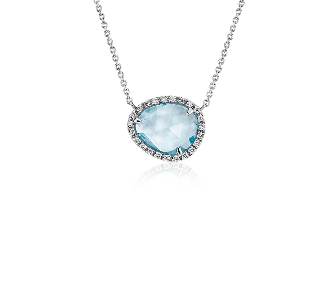 Collier halo diamants et topaze bleu ciel en or blanc 14 carats (11x9 mm)