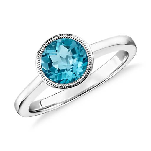 NUEVO. Blue Topaz Round Milgrain Ring in plata de ley (7 mm)