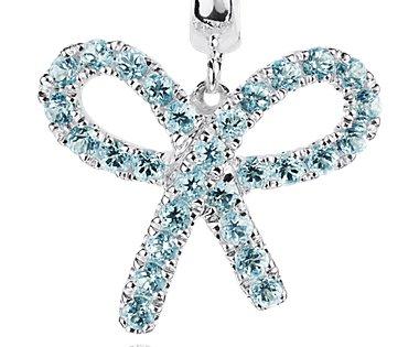 Boucles d'oreilles nœud topaze bleue en argent sterling