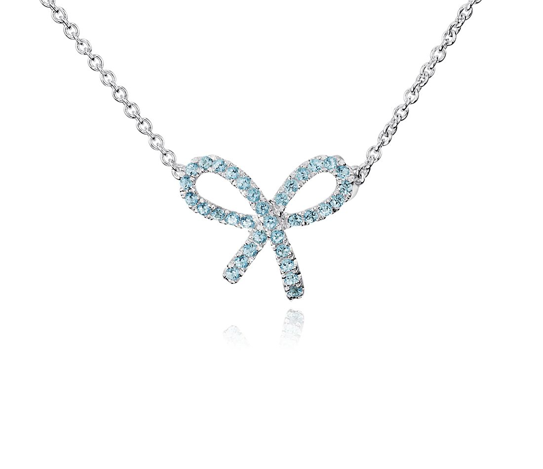 Blue Topaz Bow Pendant in Sterling Silver