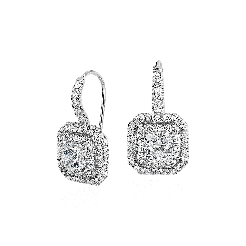 Aretes colgantes con doble halo de diamantes de talla cojín en oro blanco de 18k
