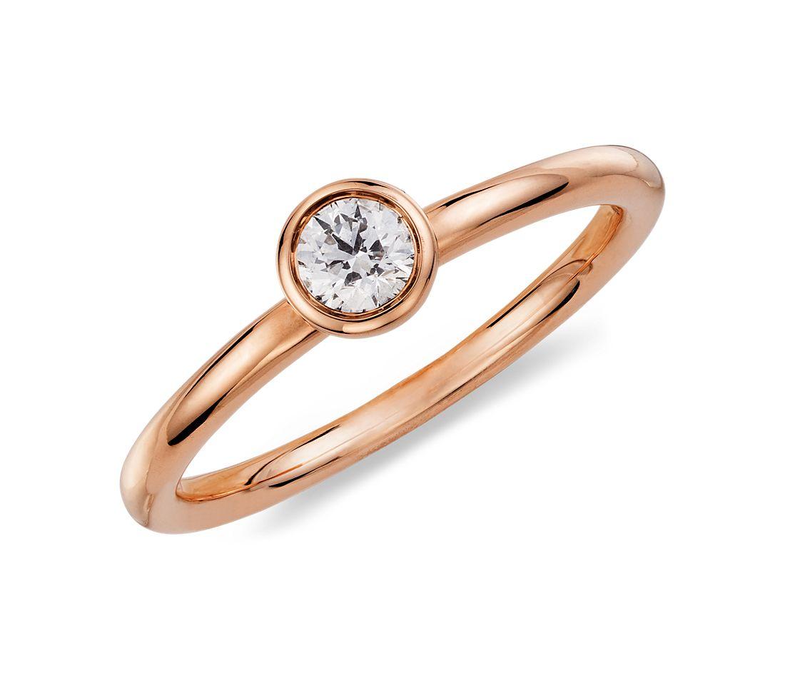 Bague diamant rond serti clos en or rose 14carats (1/5carat, poids total)