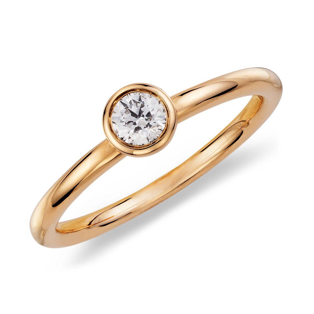 Bague diamant rond serti clos en or jaune 14carats (1/5carat, poids total)