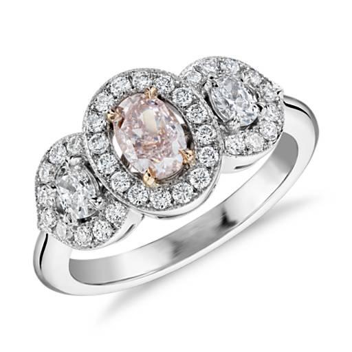 Anillo con halo diamantes y tres piedras rosa claro fantasía en platino y Oro rosado de 18k (piedra central de 0,52qt)