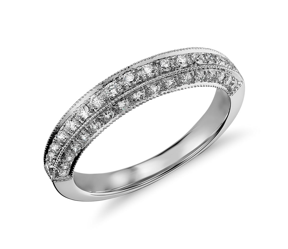 Vintage inspired, this petite diamond ring features a delicate milgrain design with pavé-set diamonds on three sides for a band with exceptional sparkle.