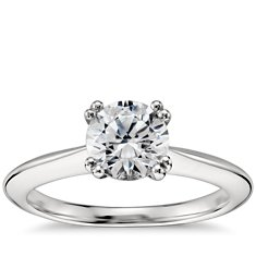Surprise Diamond Solitaire Engagement Ring in Platinum