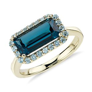 Bague halo de topazes bleues de Londres Robert Leser East-West en or jaune 14 carats (11 x 5,5 mm)