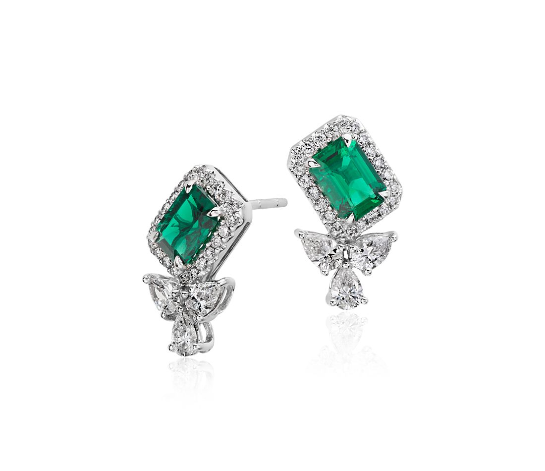 emerald and halo stud earrings in 18k white gold