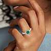 Emerald and Diamond Halo Ring in 14k White Gold (5.0mm)