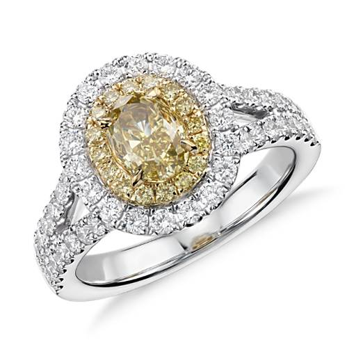 Anillo con  diamante ovalado amarillo fantasía con doble halo de diamantes. en oro blanco y amarillo de 18 k (1,94 qt. total)