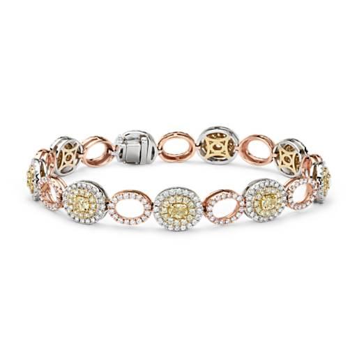 Brazalete con diamantes ovalados blancos y amarillos fantasía con halo de diamantes. en oro blanco, amarillo y rosado de 18k (5,46 qt. total)