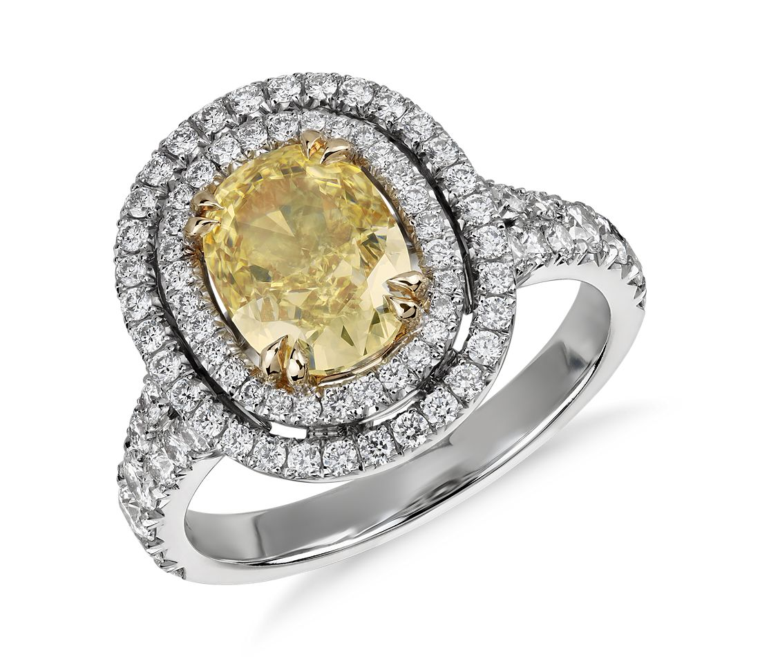 Oval Fancy Light Yellow Diamond Micropavé Halo Split Shank Ring in 18k White Gold (1.63 ct. center)