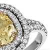 Oval Fancy Light Yellow Diamond Micropavé Halo Split Shank Ring in 18k White Gold (1.63 ct. center)