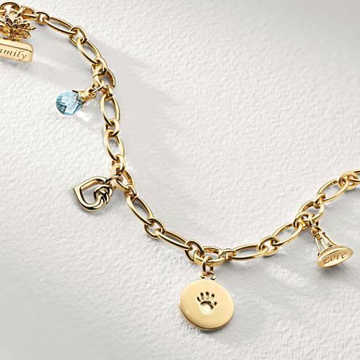 Bracelet de famille Monica Rich Kosann à cinq breloques  en or jaune 18carats