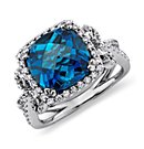 Bague volute diamants et topaze bleu de Londres en Or blanc 14 ct