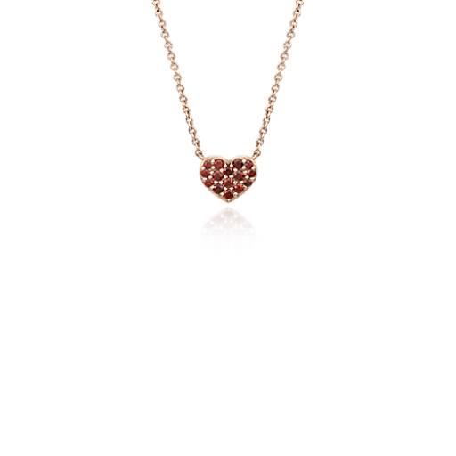Mini colgante en forma de corazón de granate en oro rosado de 14k