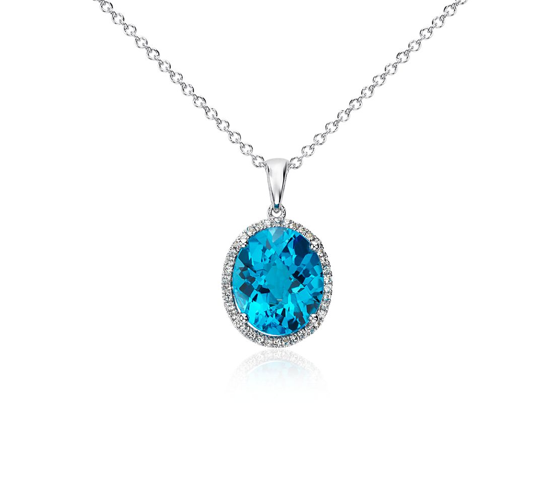 Swiss Blue Topaz and White Sapphire Halo Oval Pendant in Sterling Silver (12x10mm)
