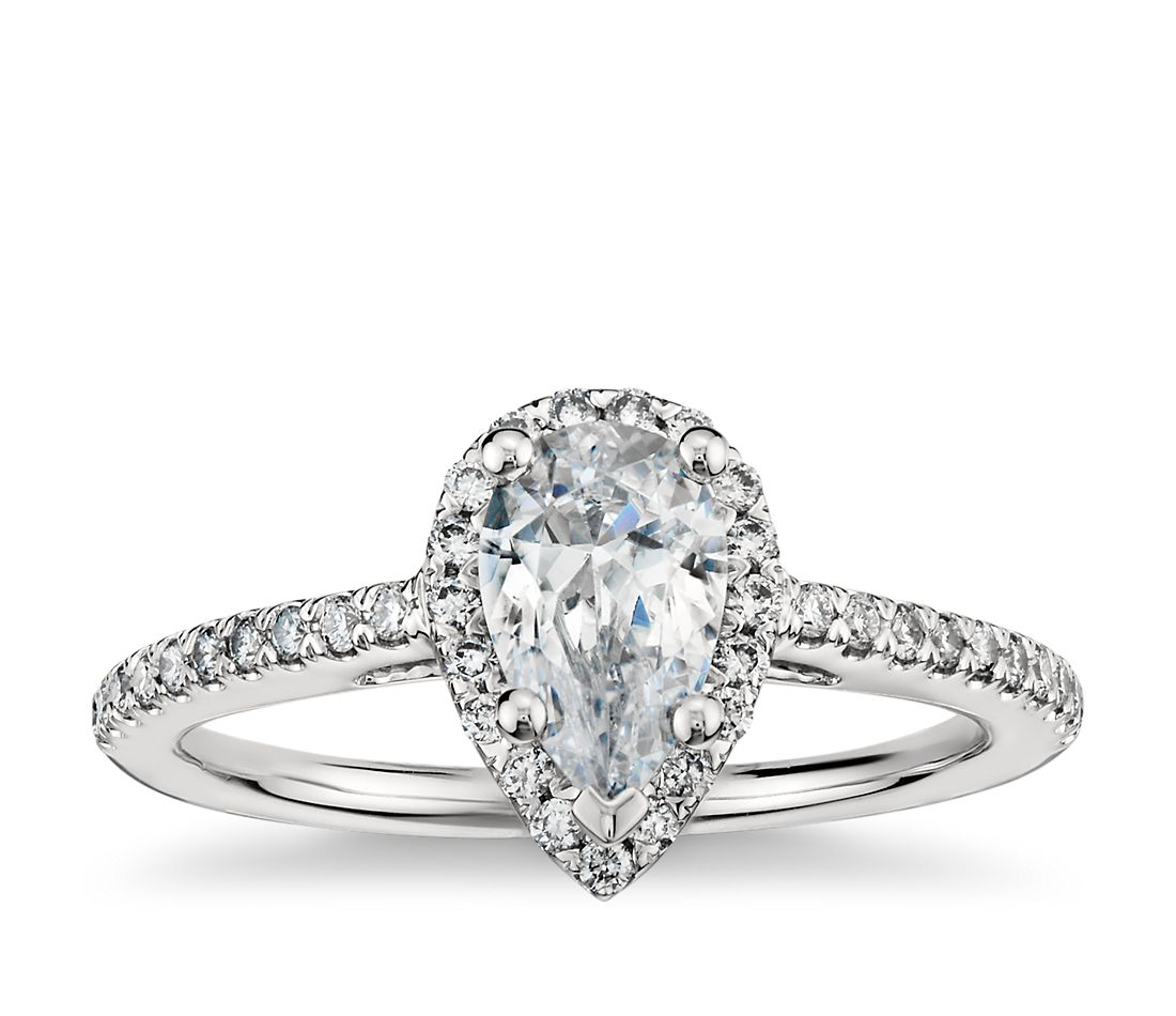 pear shaped halo diamond engagement ring in 18k white gold