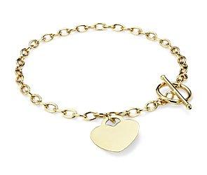 Brazalete pequeño con dije en forma de corazón en oro amarillo de 14k