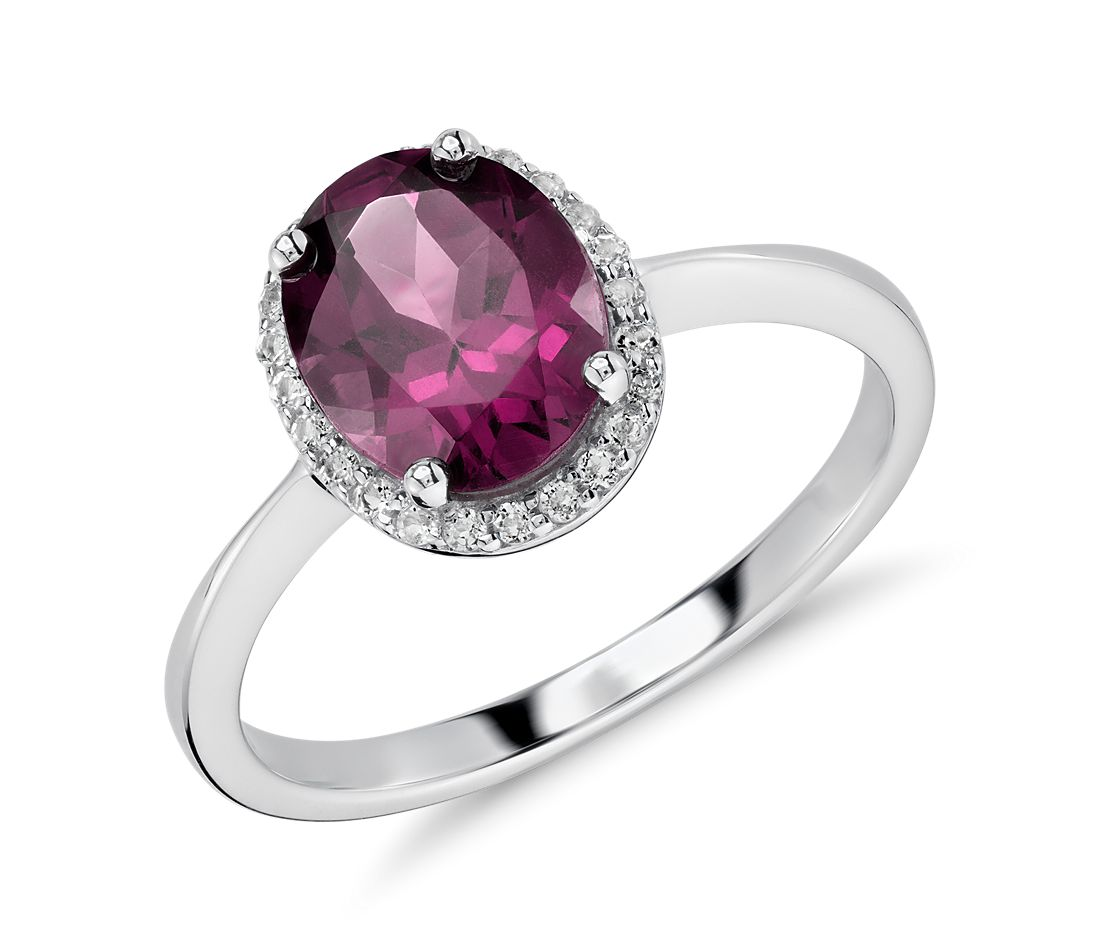 Oval Rhodolite and White Topaz Halo Ring in Sterling Silver