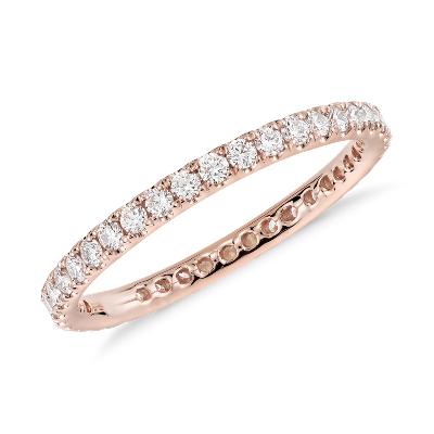 Anillo de eternidad con pavé de diamantes Riviera en oro rosado de 14k (1/2 qt. total)