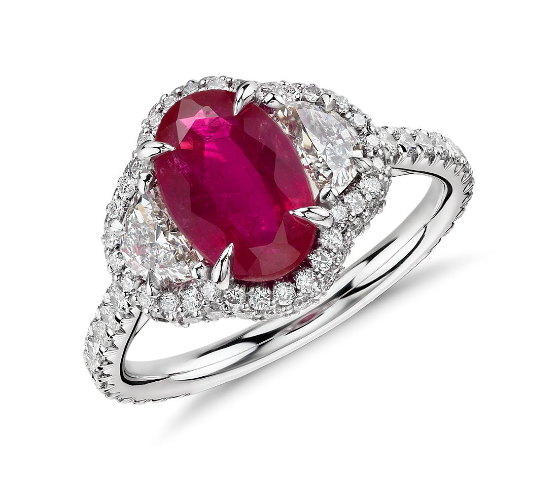 ruby and half moon halo ring in platinum and 18k