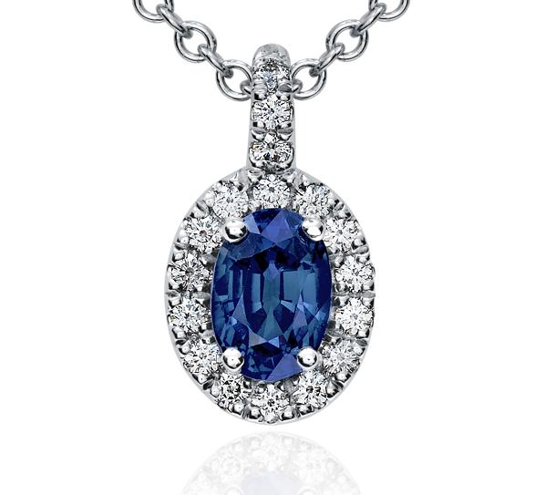 Pendentif en diamants sertis pavé et saphir bleu ovale en or blanc 18carats (7x5mm)