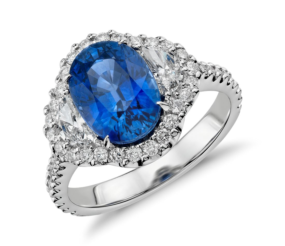 Blue Sapphire And Diamond Halo Three Stone Ring In 18k