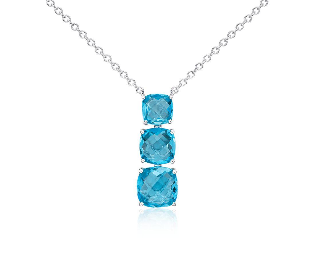 Colgante en forma de gota con tres topacios azul suizo en plata de ley